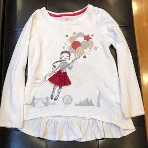 Girl's Emma's Garden long sleeve shirt.